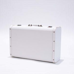 white prop suitcase