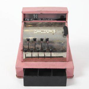 pink toy cash register prop