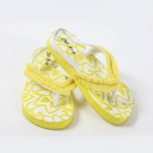 Girls yellow tongs with ruffle prop rental