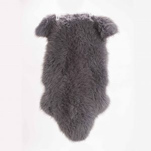 gray sheepskin rug prop